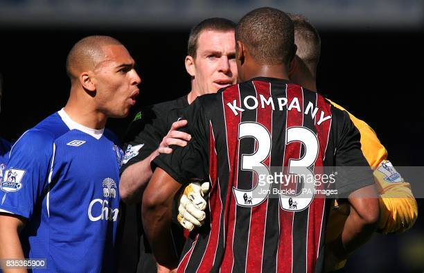 Manchester City's Vincent Kompany and Everton Richard Dunne and James Vaughan have a confrontation