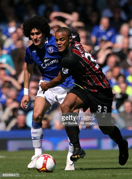 Manchester City's Vincent Kompany and Everton's Marouane Fellaini