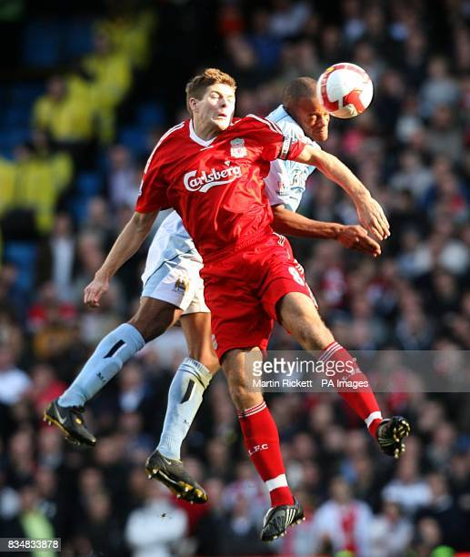 Manchester City's Vincent Kompany and Liverpool's Steven Gerrard battle for the ball in the air