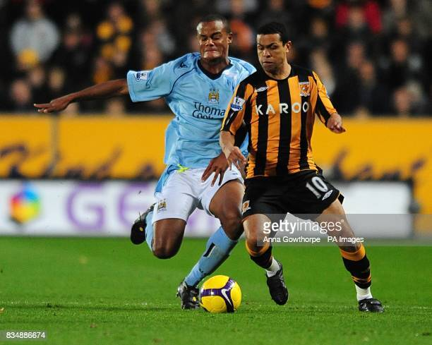 Manchester City's Vincent Kompany and Marcio Geovanni battle for the ball