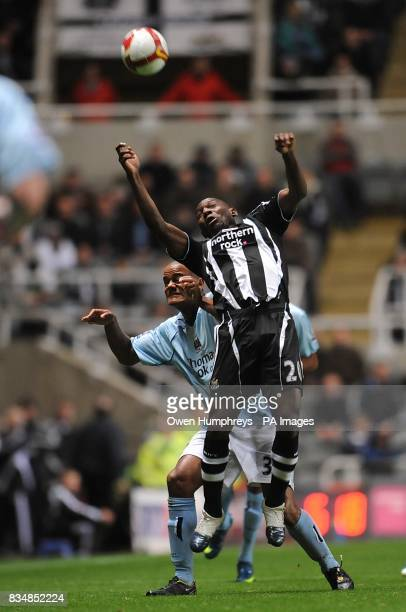 Manchester City's Vincent Kompany and Newcastle United's Geremi battle for the ball
