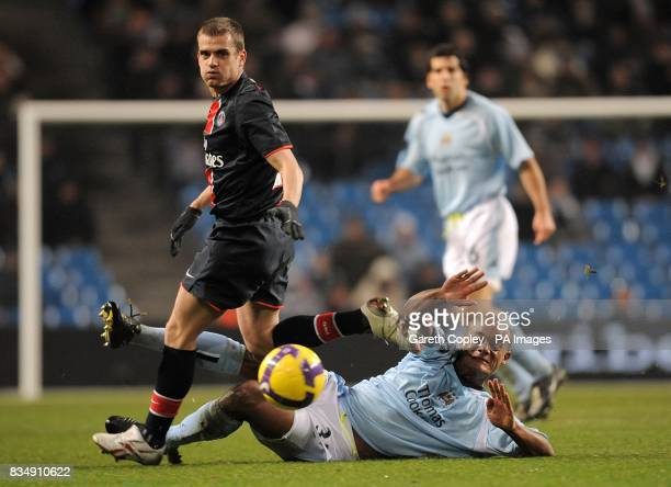Manchester City's Vincent Kompany and Paris Saint Germain's Jerome Rothen battle for the ball