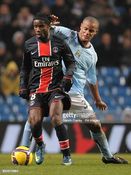 Manchester City's Vincent Kompany and Paris Saint Germain's Peguy Luyindula battle for the ball