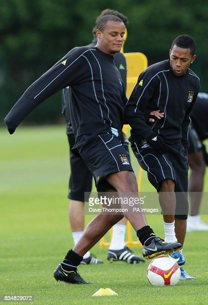 Manchester City's Vincent Kompany and Robinho during a training session at Carrington Manchester
