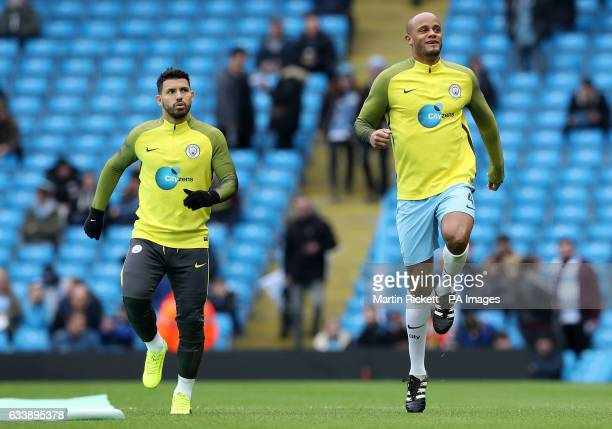 Manchester City's Vincent Kompany and Sergio Aguero who start on the bench before the Premier League match at the Etihad Stadium Manchester