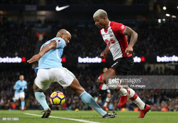 Manchester City's Vincent Kompany and Southampton's Mario Lemina battle for the ball during the Premier League match at the Etihad Stadium Manchester