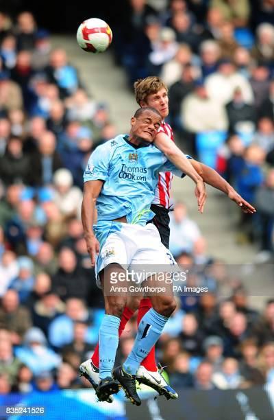 Manchester City's Vincent Kompany and Sunderland's Calum Davenport