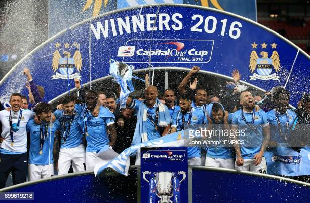 Manchester City's Vincent Kompany and team mates lift the Capital One Cup