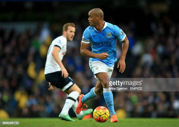 Manchester City's Vincent Kompany and Tottenham Hotspur's Harry Kane in action