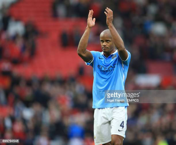 Manchester City's Vincent Kompany applauds the traveling fans after the game against Manchester United
