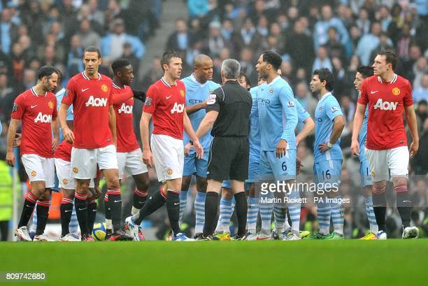 Manchester City's Vincent Kompany argues with referee Chris Foy after he is sent off for a challenge on Manchester United's Luis Nani