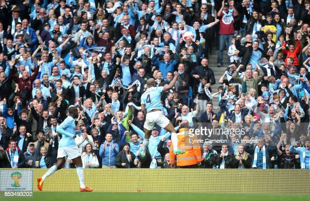 Manchester City's Vincent Kompany celebrates scoring his side's second goal in front of the fans
