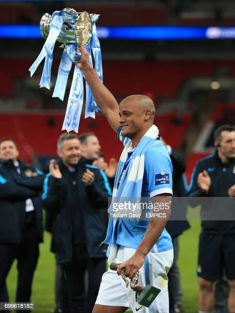 Manchester City's Vincent Kompany celebrates with the Capital One Cup trophy