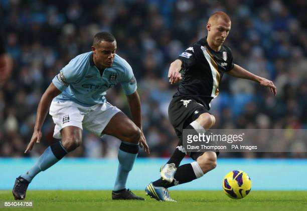Manchester City's Vincent Kompany closes down Fulham's Steve Sidwell during the Barclays Premier League match at the Etihad Stadium Manchester