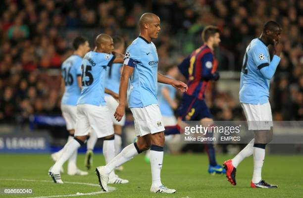 Manchester City's Vincent Kompany dejected after Barcelona score their first goal
