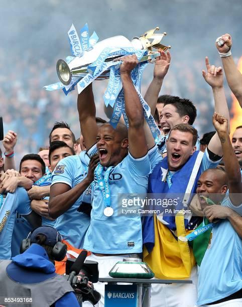 Manchester City's Vincent Kompany lifts the Barclays Premier League trophy