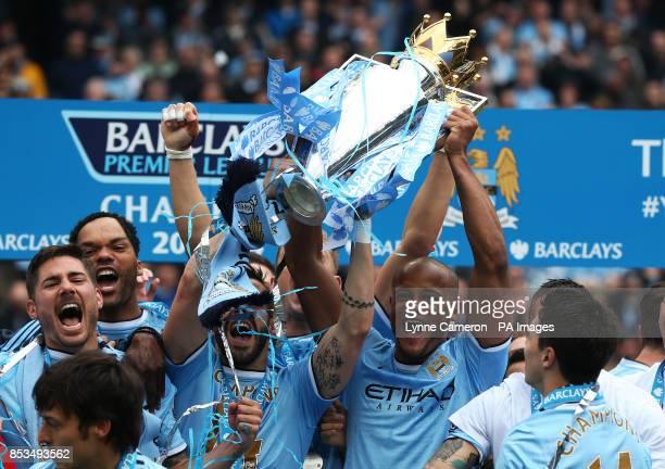 Manchester City's Vincent Kompany lifts the Barclays Premier League trophy after the Barclays Premier League match at the Etihad Stadium Manchester