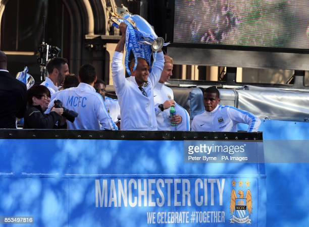 Manchester City's Vincent Kompany lifts the Premier League Trophy during the Barclays Premier League Victory Parade in Manchester