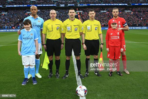 Manchester City's Vincent Kompany Liverpool's Jordan Henderson and match referee Michael Oliver before kick off