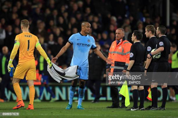 Manchester City's Vincent Kompany protests to referee Michael Oliver at the end of the first half