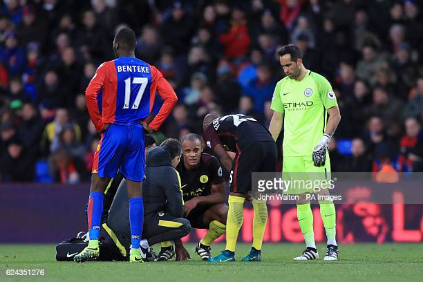 Manchester City's Vincent Kompany receives treatment for an injury during the Premier League match at Selhurst Park London