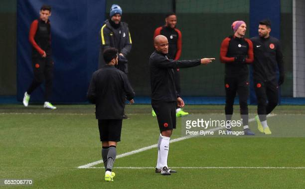 Manchester City's Vincent Kompany speaks to Gael Clichy during the training session at the City Football Academy Manchester