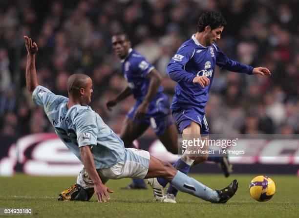 Manchester City's Vincent Kompany tackles Everton's Mikel Arteta
