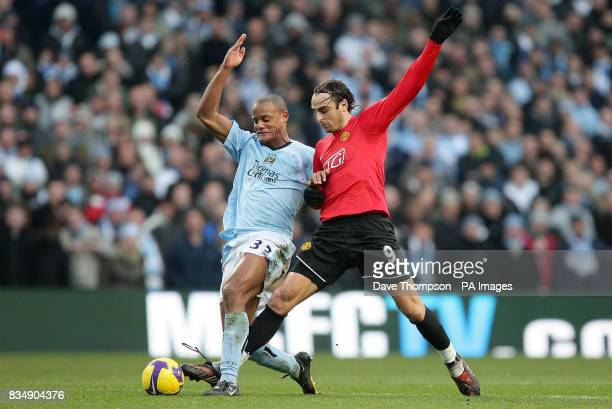 Manchester City's Vincent Kompany tussles with Manchester United's Dimitar Berbatov during the Barclays Premier League match at the City Of...