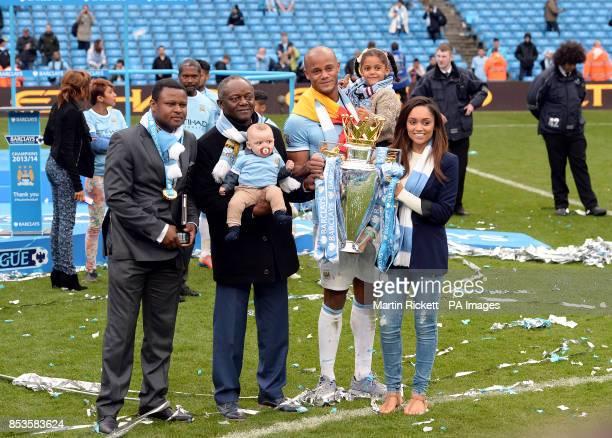 Manchester City's Vincent Kompany with the Barclays Premier League trophy