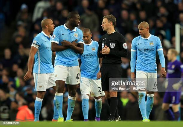Manchester City's Vincent Kompany Yaya Toure and Fernando speak with referee Mark Clattenburg after they conceed a first goal