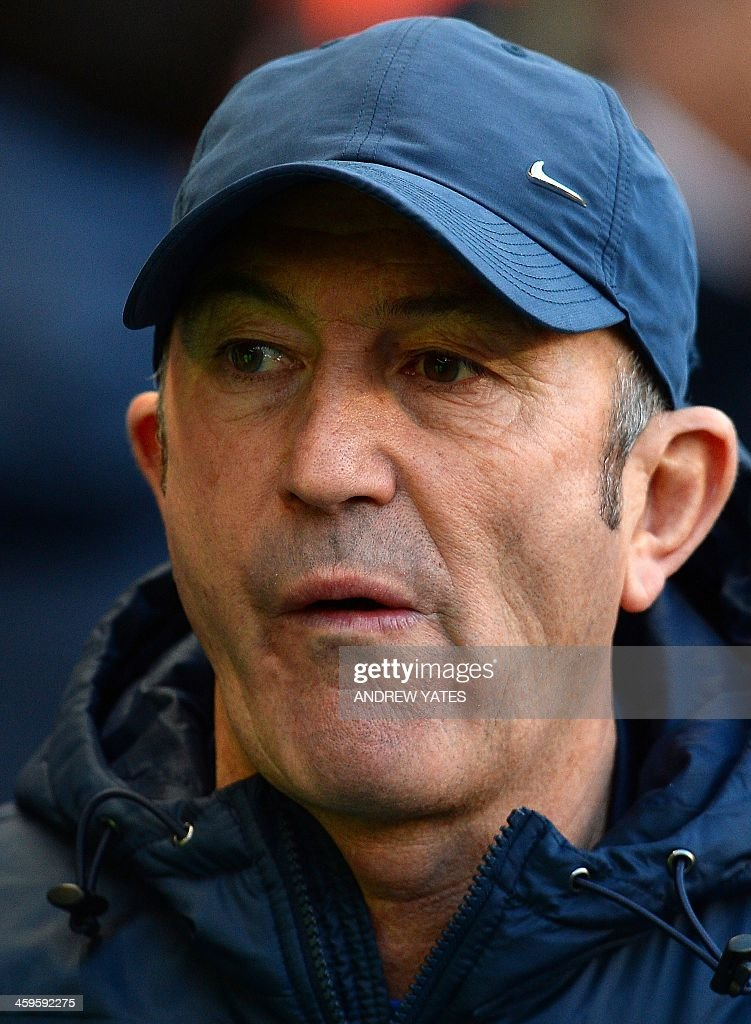 Manchester City's Welsh manager Tony Pulis looks on before the English Premier League football match between Manchester City and Crystal Palace at the Etihad Stadium in Manchester, north-west England, on December 28, 2013. Manchester City won the game 1-0. AFP PHOTO / ANDREW YATES RESTRICTED TO EDITORIAL USE. No use with unauthorized audio, video, data, fixture lists, club/league logos or live services. Online in-match use limited to 45 images, no video emulation. No use in betting, games or single club/league/player publications.