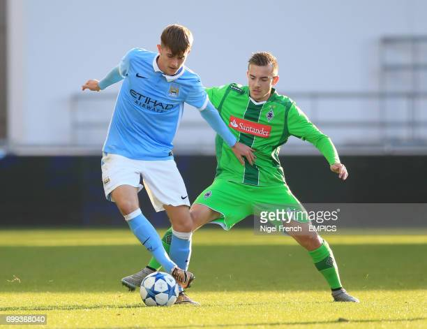 Manchester City's Will Patching and Borussia Monchengladbach's Joshua Holtby battle for the ball