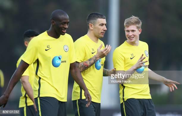 Manchester City's Yaya Toure Aleksandar Kolarov and Kevin De Bruyne during training