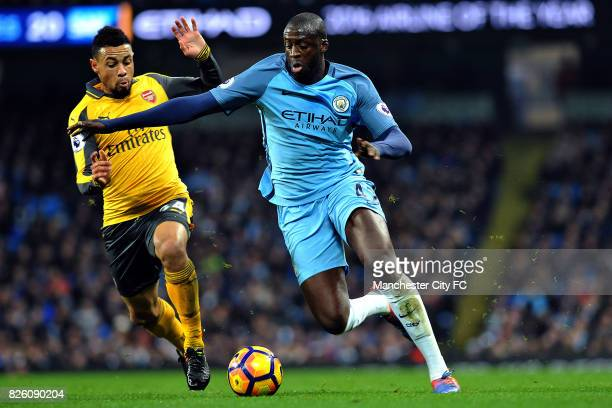 Manchester City's Yaya Toure and Arsenal's Francis Coquelin in action during the Barclay's Premiership match at the Etihad Stadium Manchester on 18th...