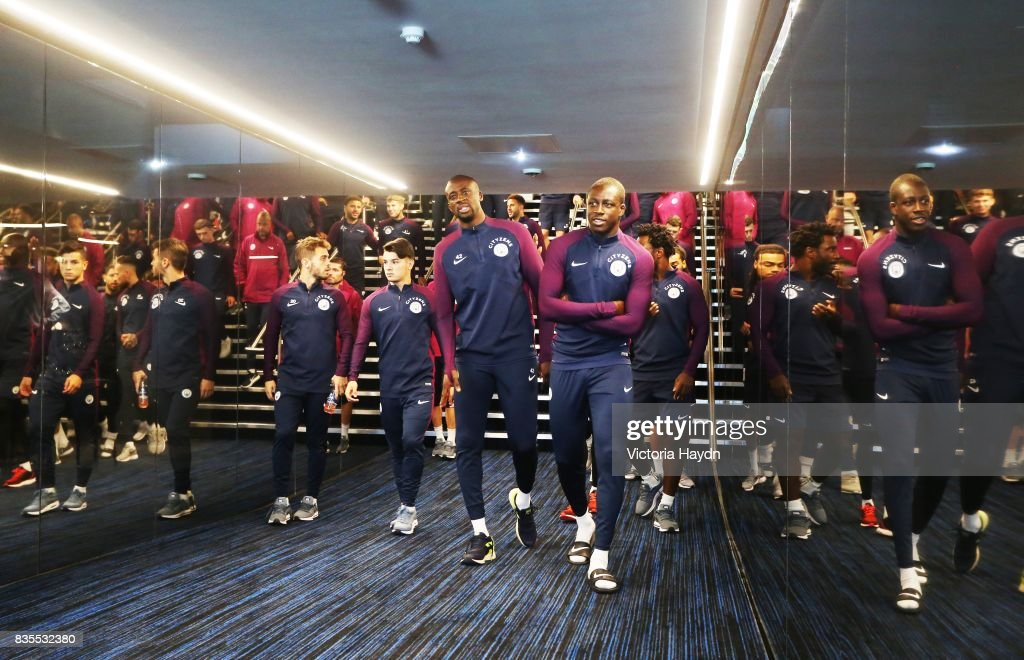 Manchester City's Yaya Toure and Benjamin Mendy walk down the new glass tunnel for the first time at Etihad Stadium on August 19, 2017 in Manchester, England.