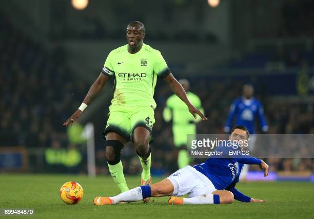 Manchester City's Yaya Toure and Everton's Muhamed Besic battle for the ball