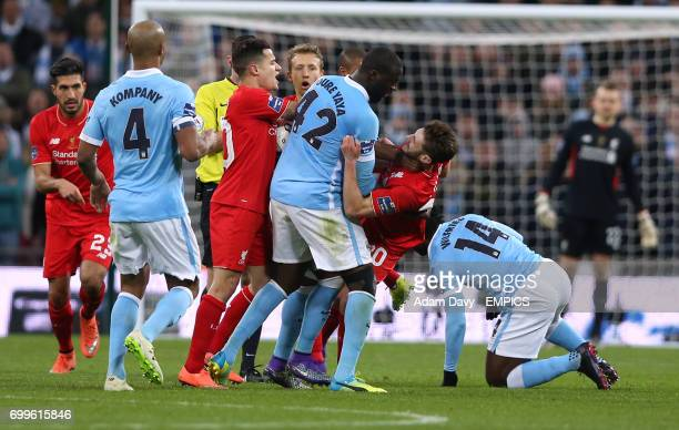 Manchester City's Yaya Toure and Liverpool's Adam Lallana come to blows over a foul