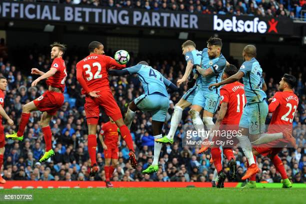 Manchester City's Yaya Toure and Liverpool's Joel Matip in action during the Barclay's Premiership match at the Etihad Stadium Manchester on 19th...
