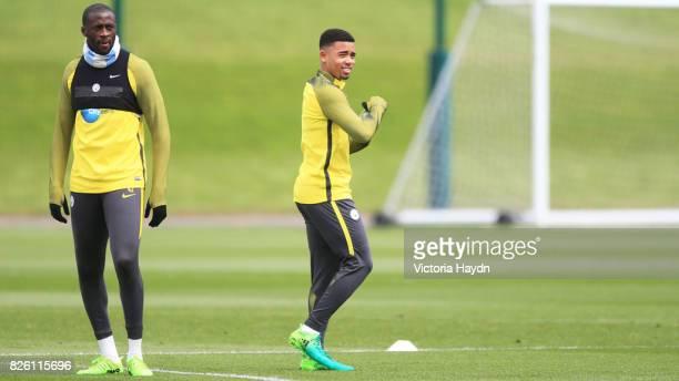 Manchester City's Yaya Toure and Manchester City's Jesus Navas during training