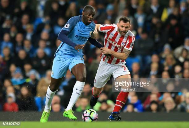 Manchester City's Yaya Toure and Stoke City's Phil Bardsley battle for the ball