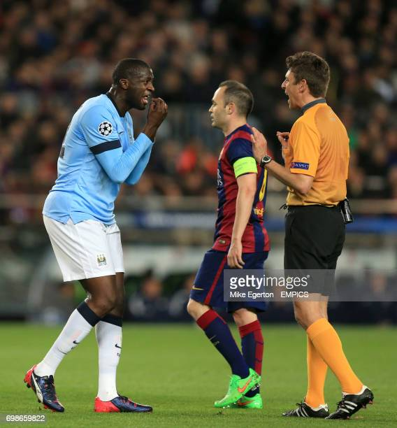 Manchester City's Yaya Toure argues with referee Gianluca Rocchi