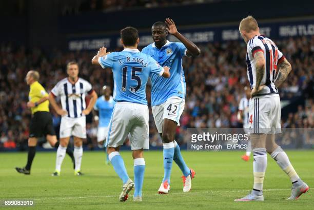 Manchester City's Yaya Toure celebrates scoring his sides second goal of the game against West Bromwich Albion with Jesus Navas