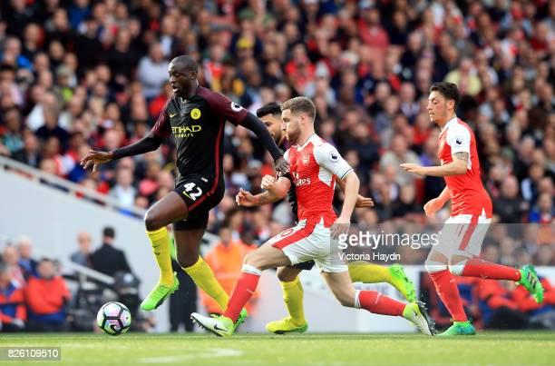 Manchester City's Yaya Toure gets away from Arsenal's Shkodran Mustafi