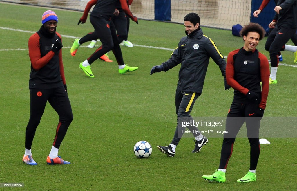 Manchester City's Yaya Toure (left) shares a joke with Leroy Sane (right) and coach Mikel Arteta during the training session at the City Football Academy, Manchester.