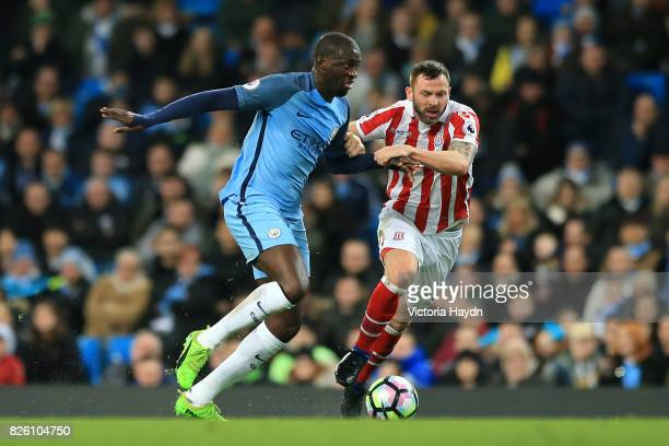 Manchester City's Yaya Toure Stoke City's Phil Bardsley battle for the ball