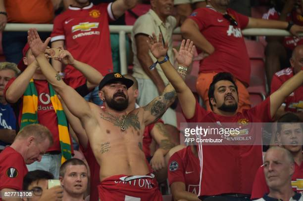 Manchester fans cheer for their team prior to the UEFA Super Cup football match between Real Madrid and Manchester United on August 8 at the Philip...