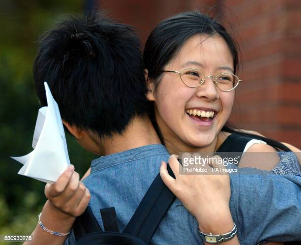 Manchester High School for girl's pupil Wing Shan Lee celebrates with a friend after achieving 6 A grade Alevels despite working 5 nights a week in...