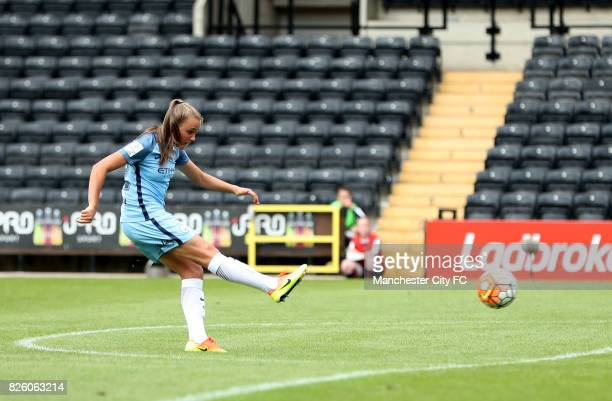 Manchester Jane Ross scores her side's fourth goal of the game