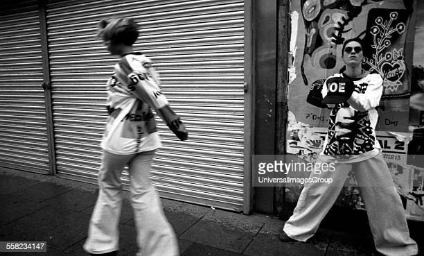 Manchester kids in Joe Bloggs flares and baggy tops skip down the street Manchester 1988