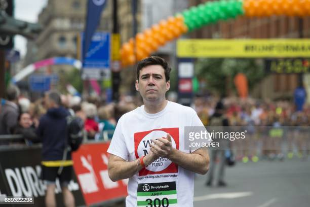 Manchester mayor Andy Burnham is seen before the start of the Great Manchester Run in Manchester north west England on May 28 2017 Britain police...